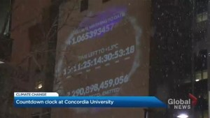 Doomsday climate clock projected onto Concordia University building